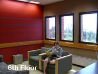 Image of a woman sitting on the third floor of the Owen Science and Engineering Library.